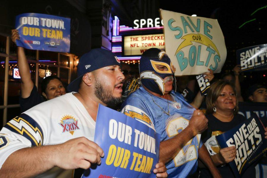 A San Diego Chargers fans cheer in front of the Spreckels Theatre during a hearing hosted by the NFL to gather comments from football fans on the possible relocation of the San Diego Chargers to Los Angeles Wednesday, Oct. 28, 2015, in San Diego. (AP Photo/Gregory Bull)