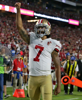 San Francisco 49ers quarterback Colin Kaepernick (7) celebrates his touchdown against the Arizona Cardinals during the second half of an NFL football game, Sunday, Nov. 13, 2016, in Glendale, Ariz. (AP Photo/Rick Scuteri)