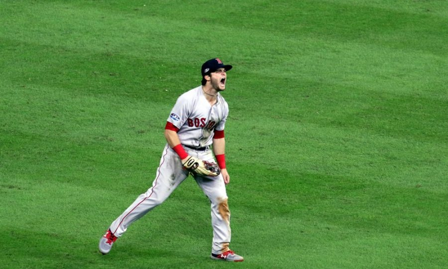 Oct 17, 2018; Houston, TX, USA; Boston Red Sox left fielder Andrew Benintendi (16) celebrates after making a game ending diving catch during the ninth inning against the Houston Astros in game four of the 2018 ALCS playoff baseball series at Minute Maid Park. Mandatory Credit: John Glaser-USA TODAY Sports ORG XMIT: USATSI-391828 ORIG FILE ID:  20181017_cja_ga2_145.JPG