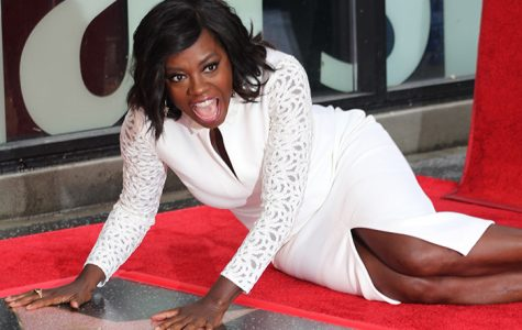 Actress Viola Davis poses on her star on the Hollywood Walk of Fame during ceremonies Jan. 5. (Photo by Tyrone Cole; wave newspaper)