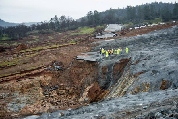 Despite current inclement weather, work continues on the area below the Oroville Dam emergency spillway, located in Oroville, California. Rock, aggregate, and cement slurry continue to be placed into areas affected by erosion. This work will continue 24 hours a day. The California Department of Water Resources continues to aggressively monitor the status of the dam, spillways, the Hyatt Power Plant, related structures, and progress of repair activities. Photo taken on February 19, 2017. Florence Low / California Department of Water Resources, FOR EDITORIAL USE ONLY