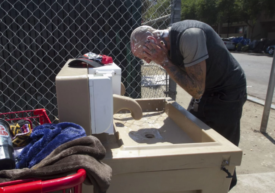 Jaime Lynn Hines on Sept. 5 at one of the hand-washing. John Gibbins/San Diego Union-Tribune