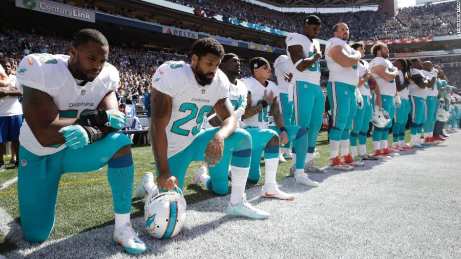 Taking a Knee to Take a Stand