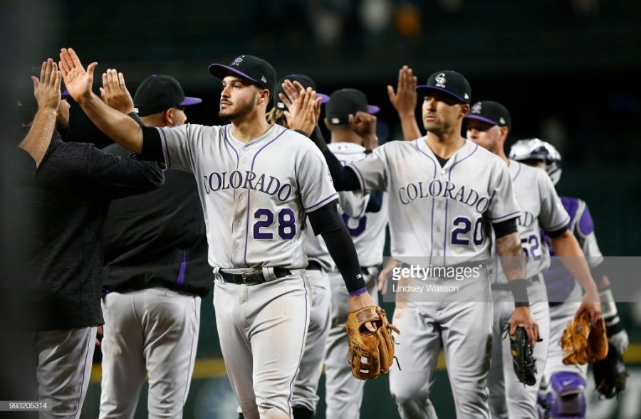 SEATTLE, WA - JULY 06:  Nolan Arenado #28 of the Colorado Rockies  and Ian Desmond #20 of the Colorado Rockies greet their teammates as they celebrate their win against the Seattle Mariners at Safeco Field on July 6, 2018 in Seattle, Washington. (Photo by Lindsey Wasson/Getty Images)
