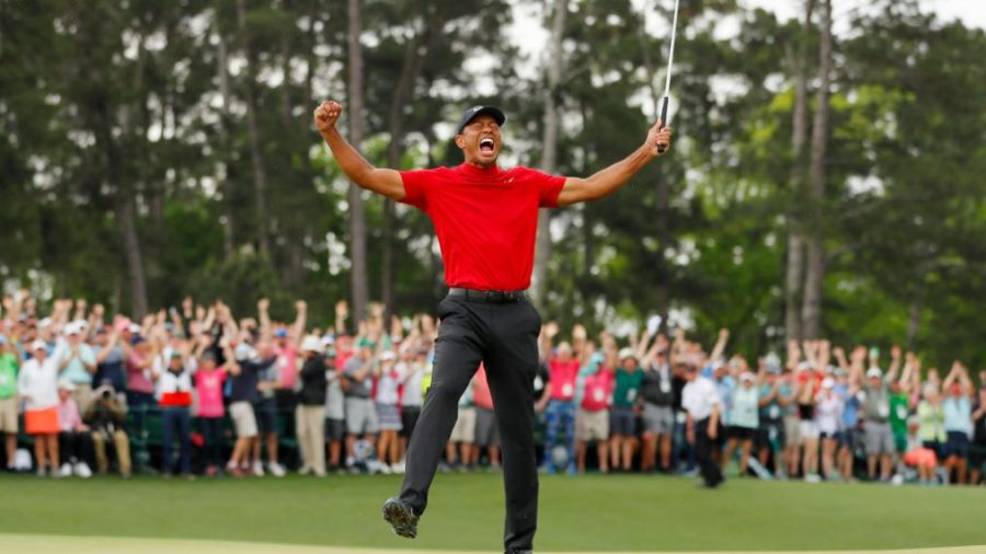 AUGUSTA, GEORGIA - APRIL 14: Tiger Woods of the United States celebrates after sinking his putt on the 18th green to win during the final round of the Masters at Augusta National Golf Club on April 14, 2019 in Augusta, Georgia. (Photo by Kevin C. Cox/Getty Images)